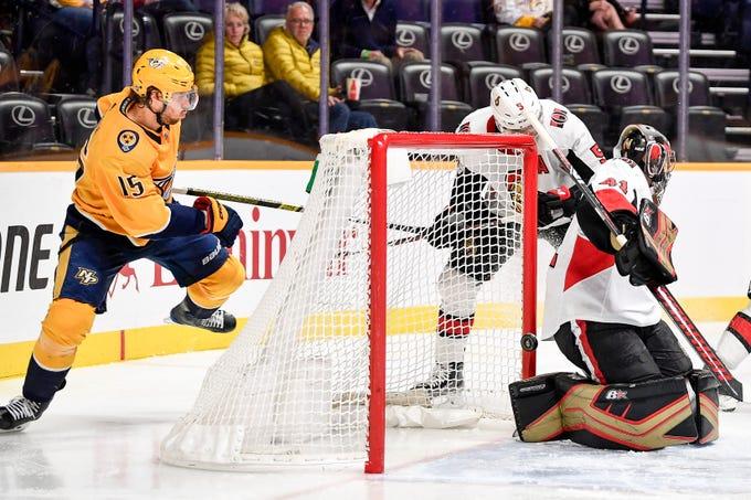 Nashville Predators right wing Craig Smith (15) scores against Ottawa Senators goaltender Craig Anderson (41) during the third period at Bridgestone Arena in Nashville, Tenn., Tuesday, Dec. 11, 2018.