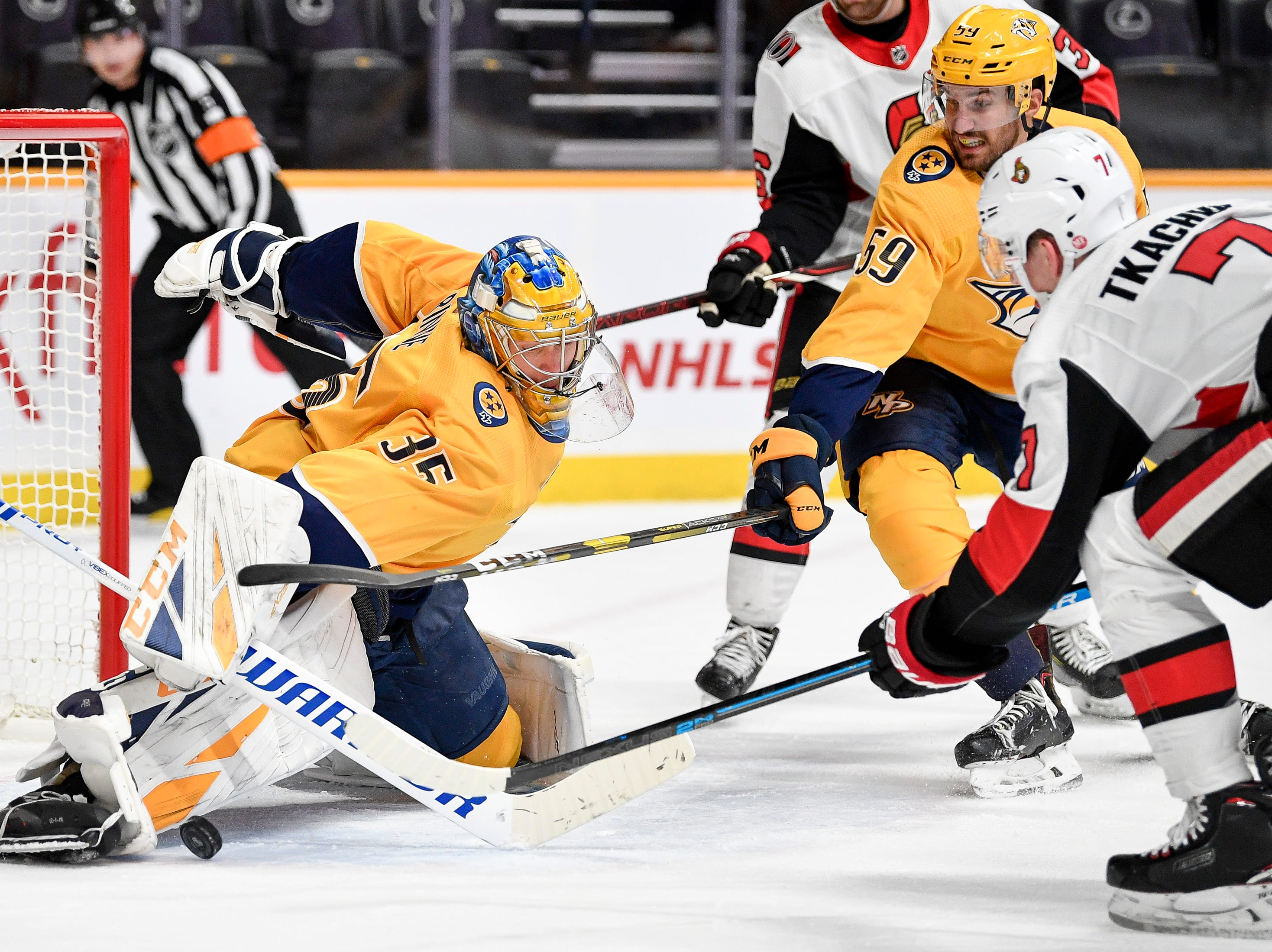 Nashville Predators goaltender Pekka Rinne (35) blocks a shot from Ottawa Senators left wing Brady Tkachuk (7) during the second period at Bridgestone Arena in Nashville, Tenn., Tuesday, Dec. 11, 2018.