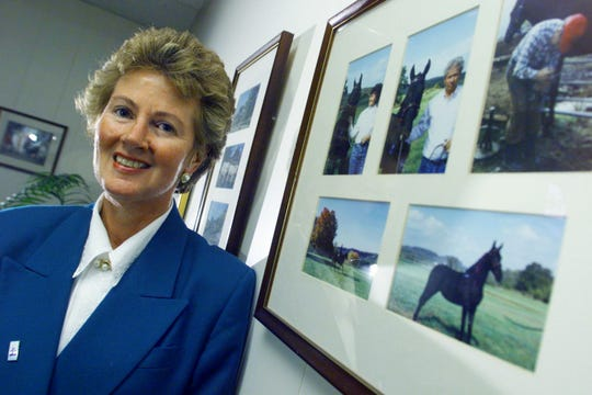 Senior Citizens Inc. executive director Janet Jernigan poses with photos from her farm in her Nashville office Dec. 3, 1999.