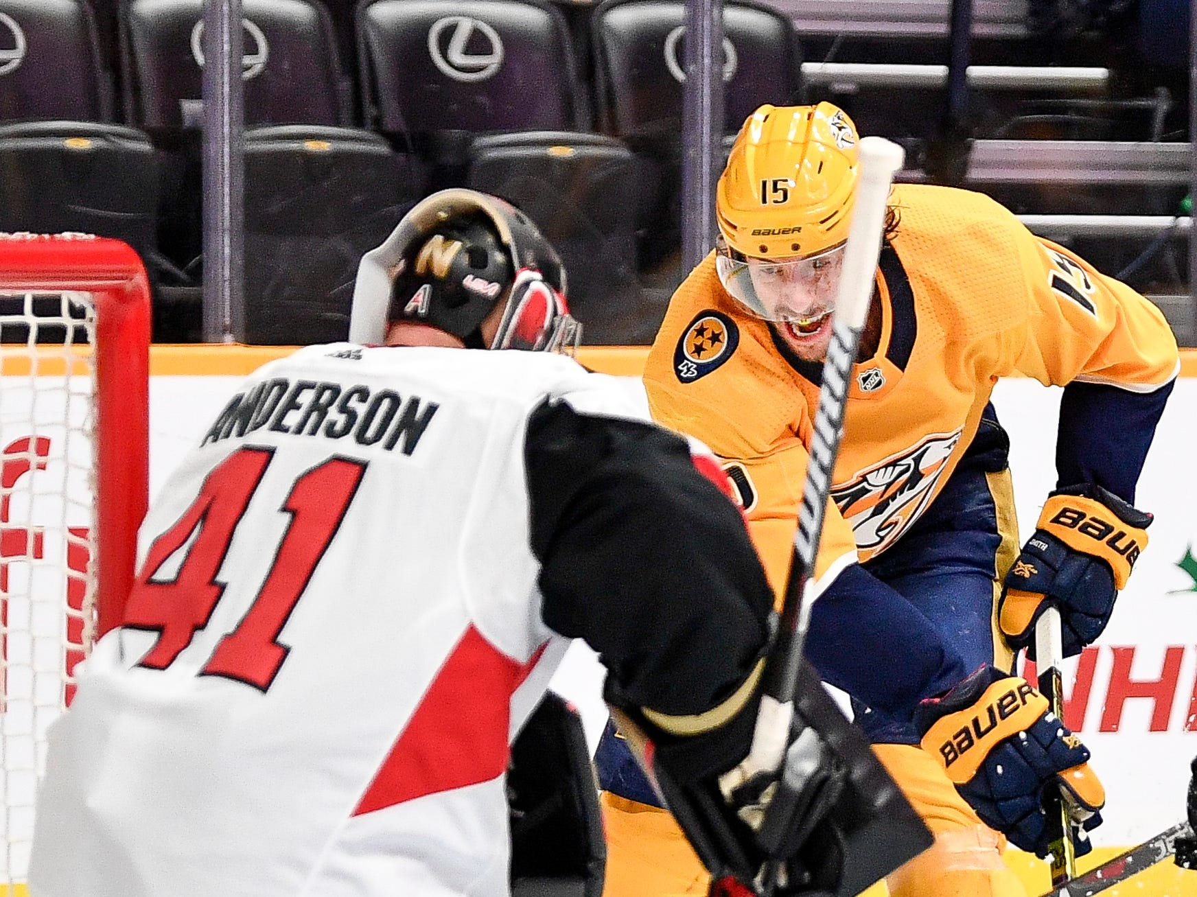 Nashville Predators right wing Craig Smith (15) moves in to score a goal against Ottawa Senators goaltender Craig Anderson (41) during the third period at Bridgestone Arena in Nashville, Tenn., Tuesday, Dec. 11, 2018.