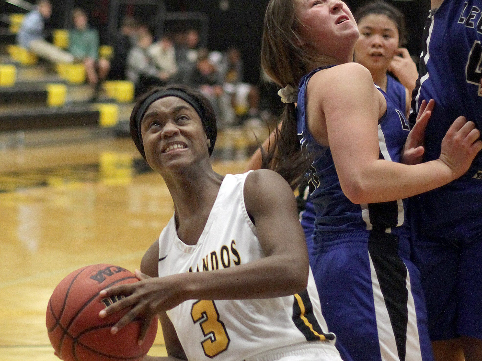 Hendersonville's Janaeya Mayes drives against Lebanon on Tuesday, December 11, 2018.
