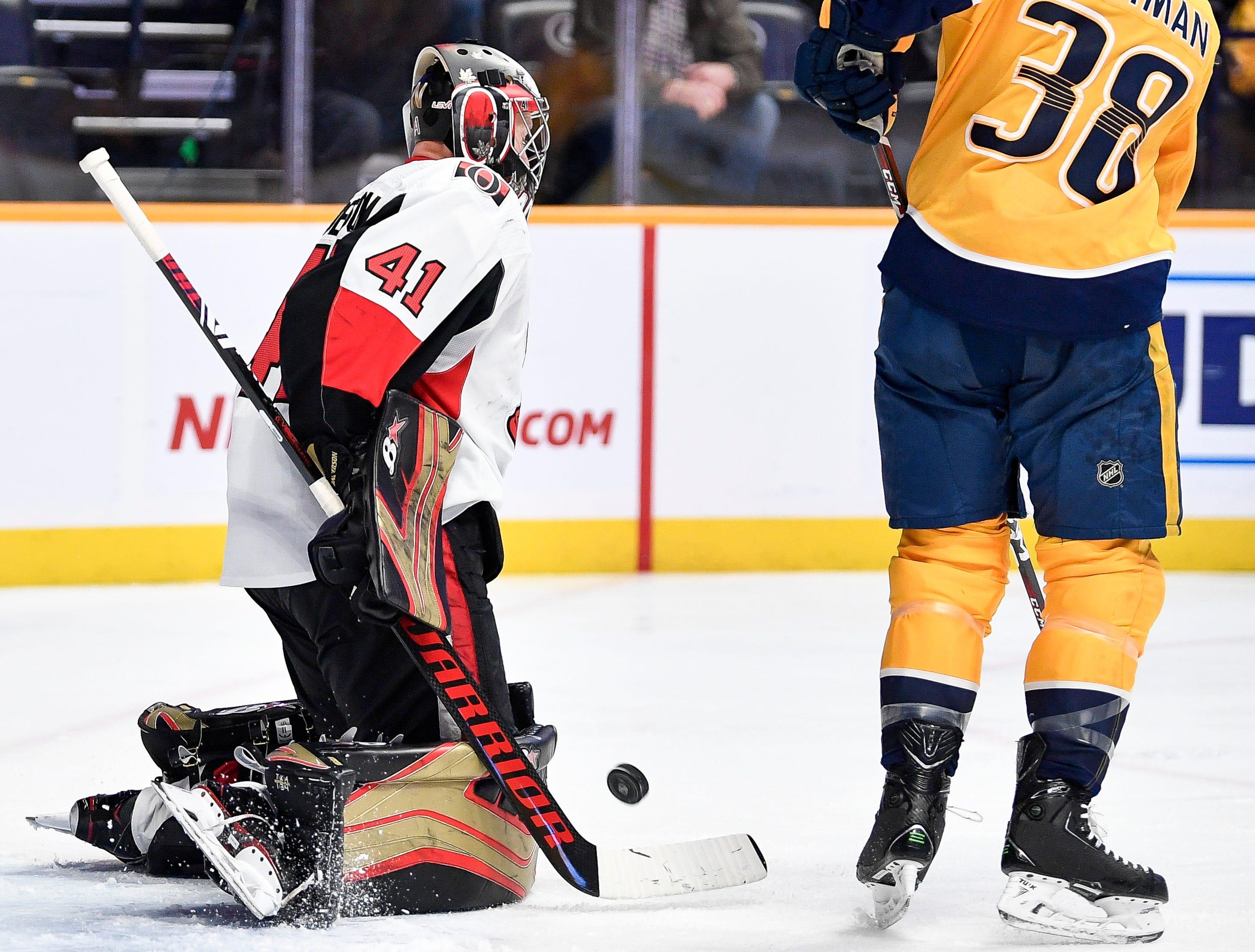 Ottawa Senators goaltender Craig Anderson (41) battles against Nashville Predators right wing Ryan Hartman (38) during the third period at Bridgestone Arena in Nashville, Tenn., Tuesday, Dec. 11, 2018.