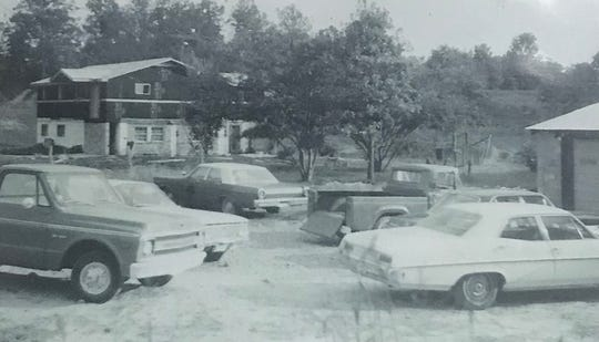 An old black-and-white photograph of Varden's Body Shop and the family home next door.