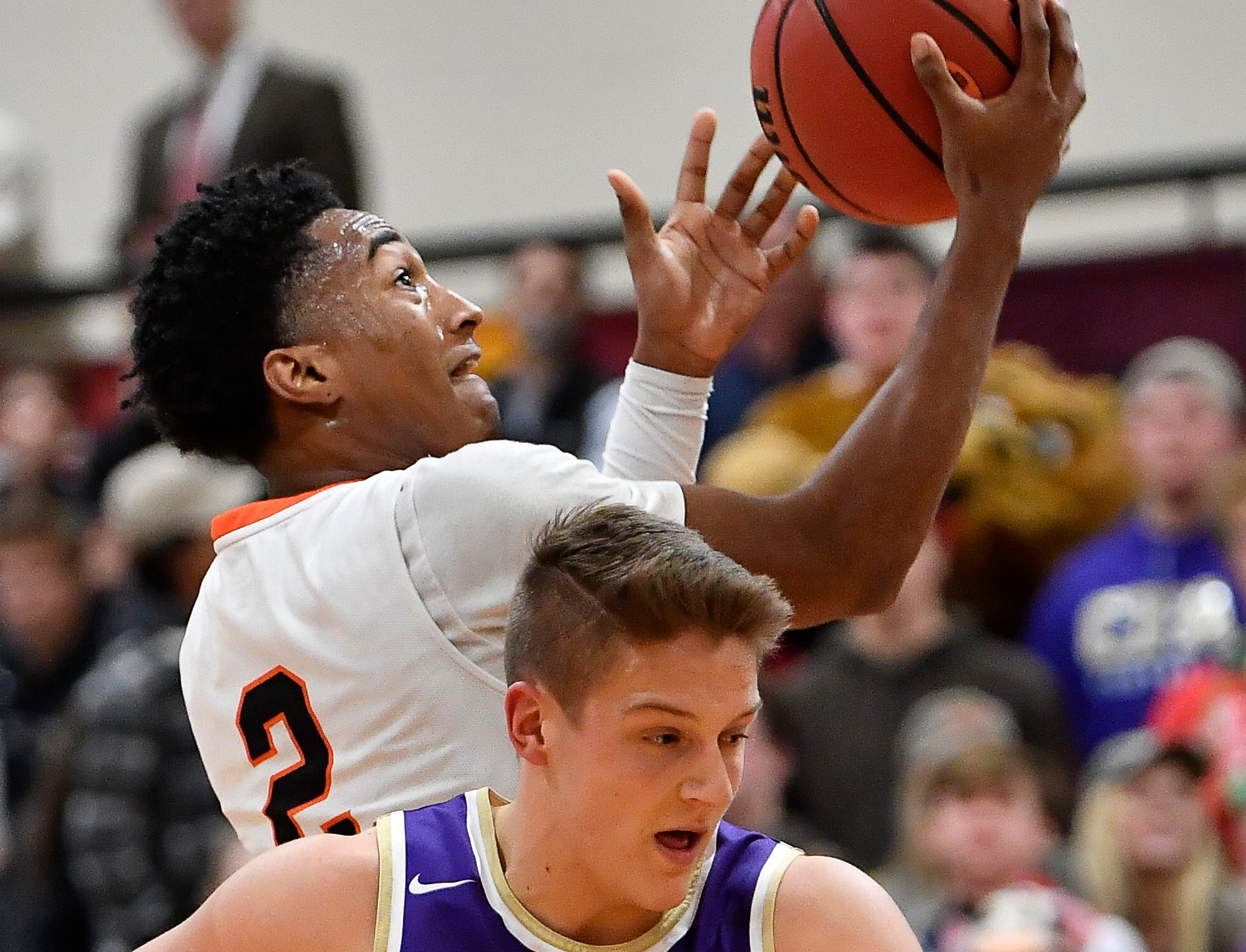 Ensworth guard Lewis McDaniel (2) shoots over CPA's McNeill Stout (5) during their game at Ensworth High School Tuesday, Dec. 11, 2018, in Nashville, Tenn.