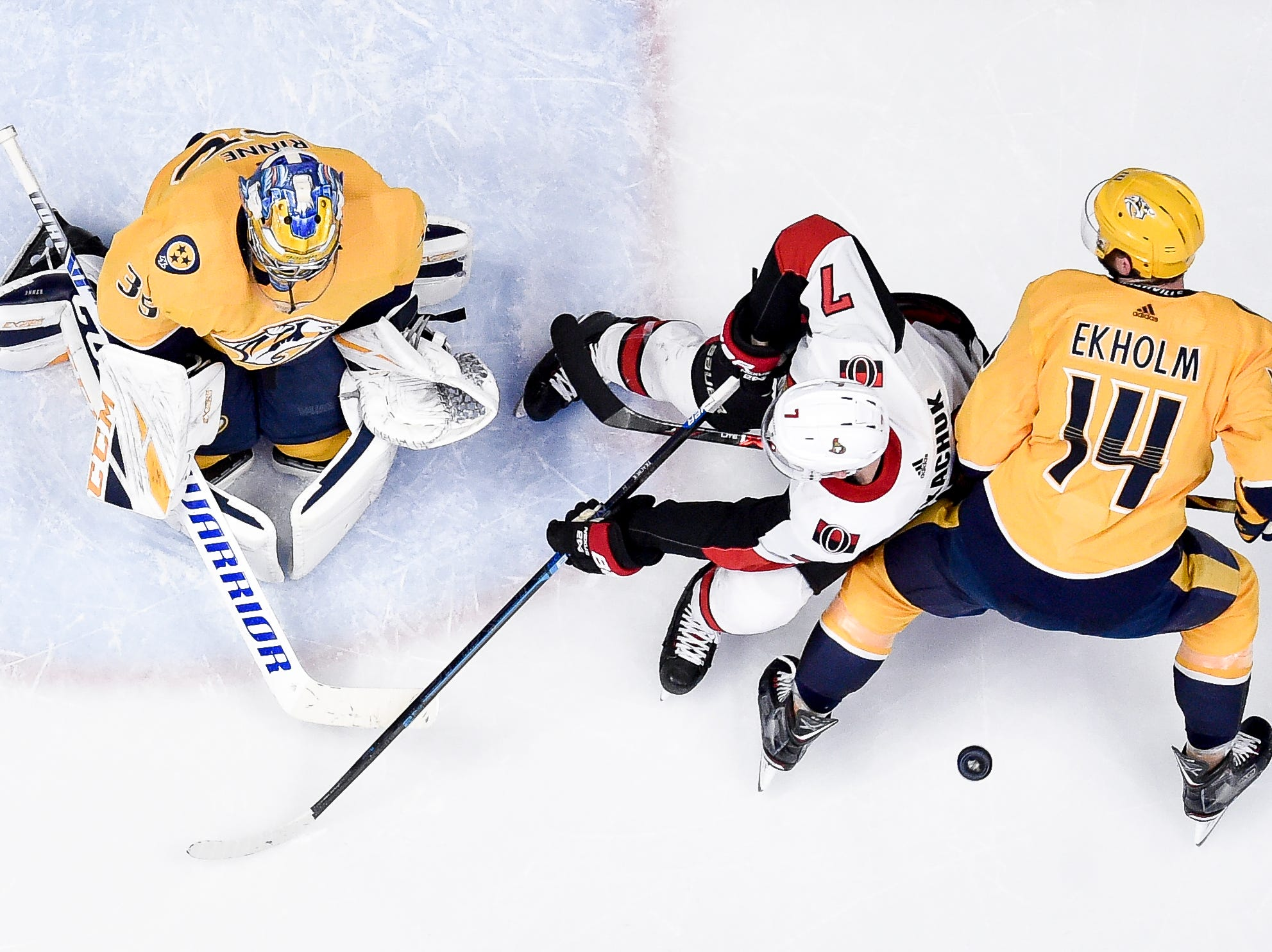 Nashville Predators goaltender Pekka Rinne (35) and defenseman Mattias Ekholm (14) defend against Ottawa Senators left wing Brady Tkachuk (7) during the third period at Bridgestone Arena in Nashville, Tenn., Tuesday, Dec. 11, 2018.