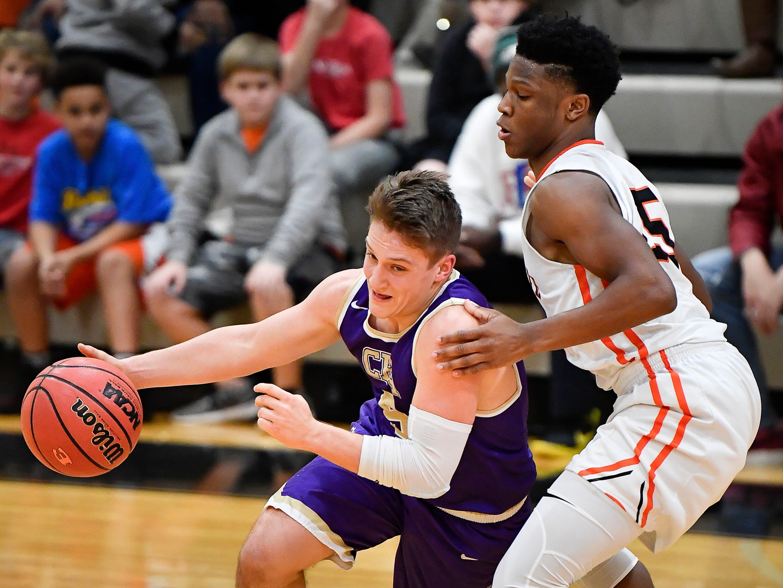 CPA's McNeill Stout (5) drives past Ensworth guard Jai Morris (15) during their game at Ensworth High School Tuesday, Dec. 11, 2018, in Nashville, Tenn.