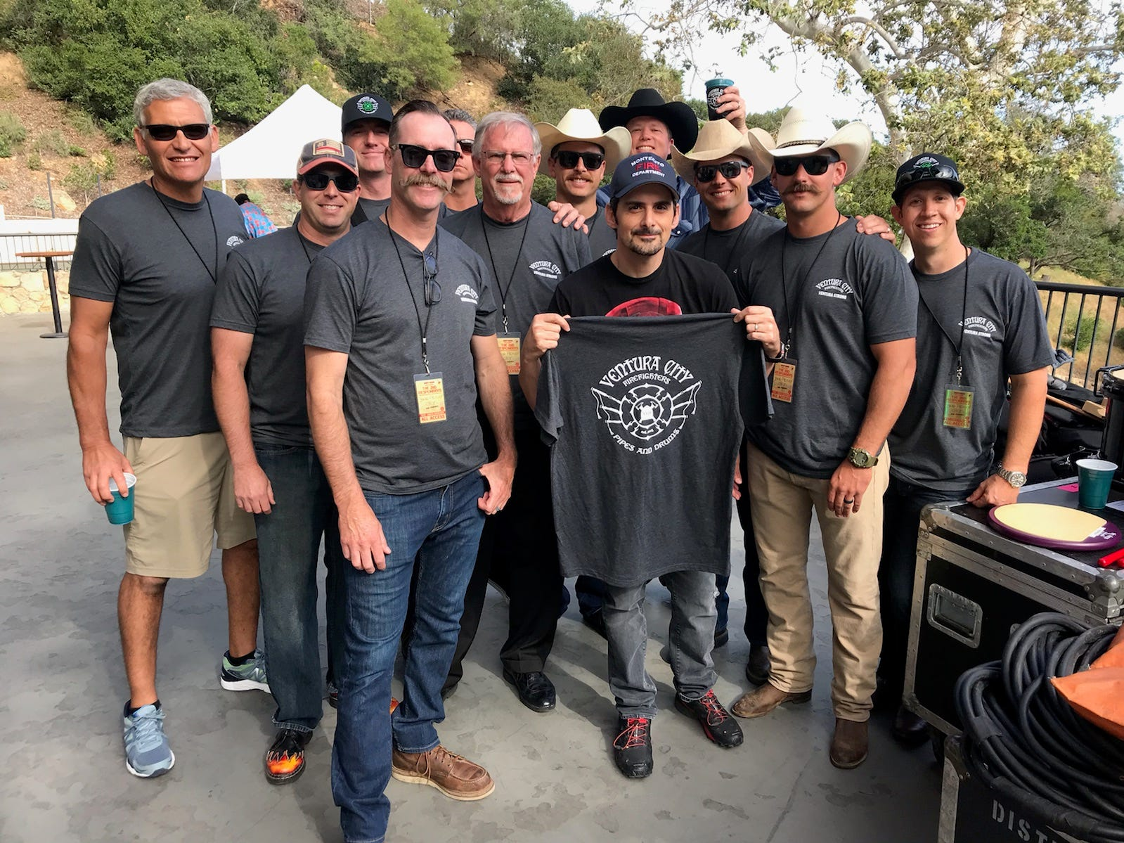 Brad Paisley, center, poses with the Ventura City firefighters pipe and drum band before he plays a benefit show May 12, 2018, for victims of California wildfires and mudslides in Santa Barbara