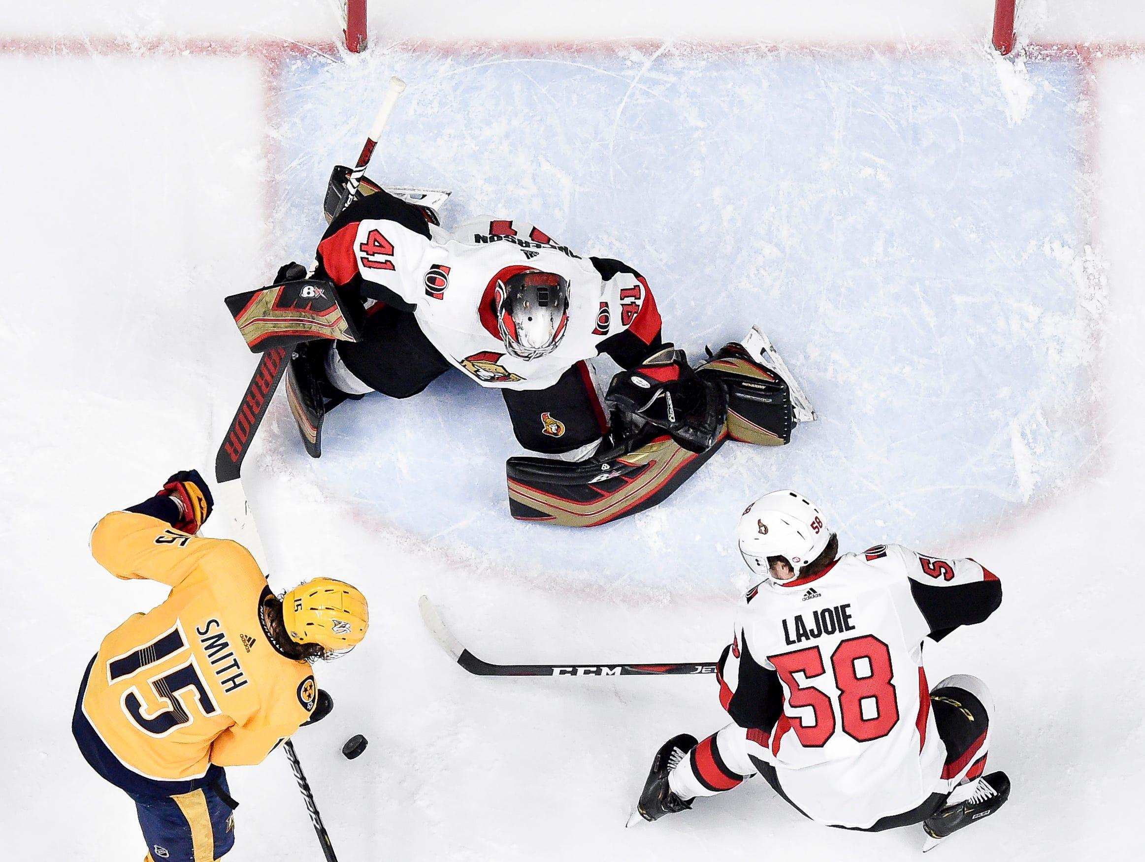 Nashville Predators right wing Craig Smith (15) battles with Ottawa Senators goaltender Craig Anderson (41) and defenseman Maxime Lajoie (58) during the second period at Bridgestone Arena in Nashville, Tenn., Tuesday, Dec. 11, 2018.