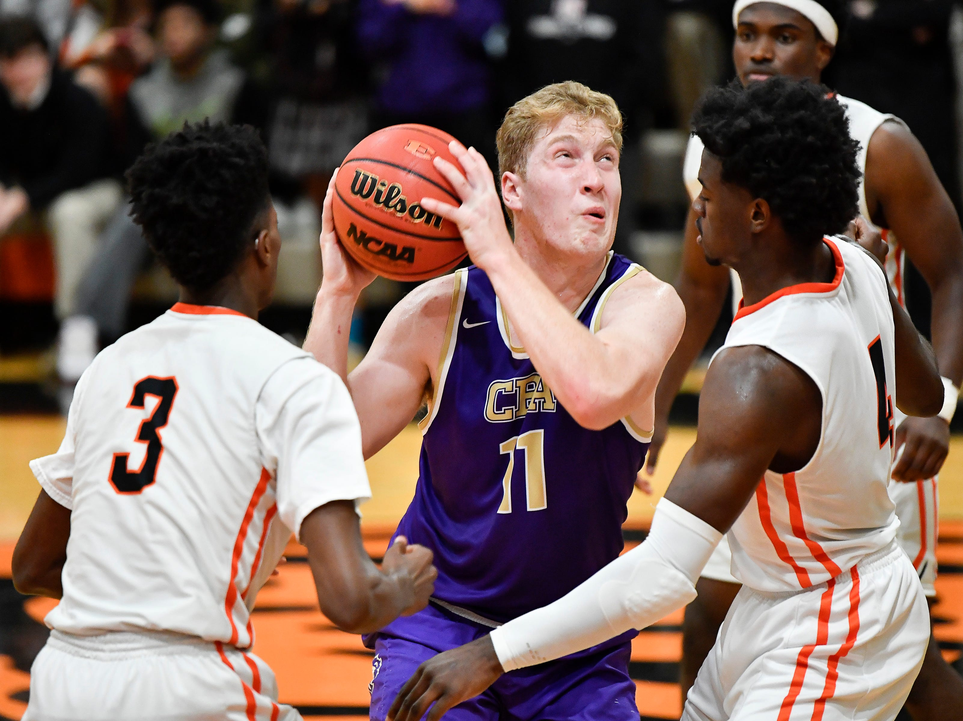 CPA's Dean Cooper (11) tries to shoot past Ensworth guard Key Collier (3) and forward Keshawn Lawrence (4) during their game at Ensworth High School Tuesday, Dec. 11, 2018, in Nashville, Tenn.