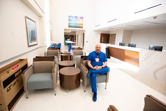 Wendell McClurg, systems director of operations for emergency services, sits in the NCH Healthcare Bonita lobby on Wednesday, Dec. 12, 2018. The facility is having its grand opening on Saturday, Dec. 15, 2018. McClurg has worked with NCH for about seven years and been a part of four emergency services projects with NCH.