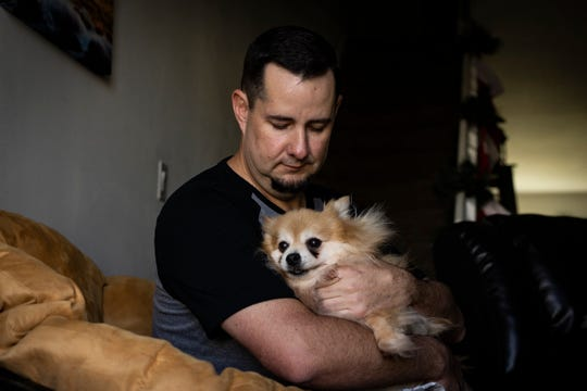 Andrew Meunier holds his Pomeranian, Howie, at his home Tuesday morning, Dec. 11, 2018. Meunier was with Howie when he was attacked in his backyard in January. Although Howie may have been jumpy the night of the attack, Meunier thinks Howie probably doesn't remember the incident.