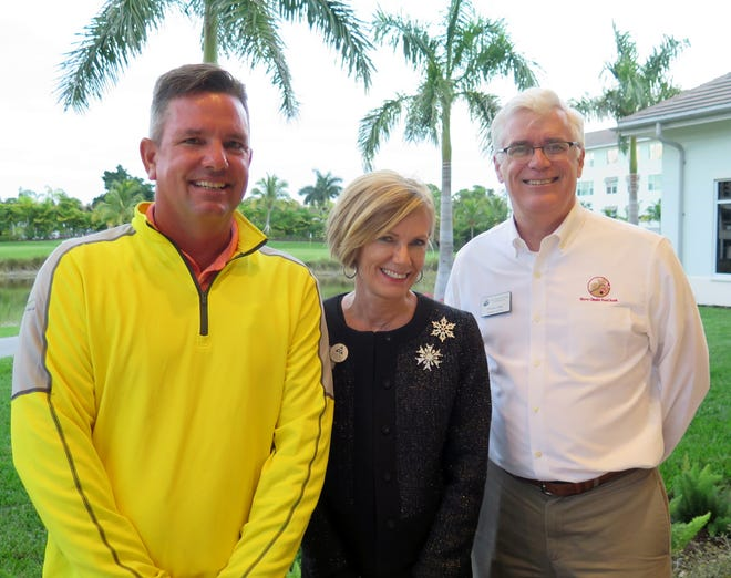 Vi at Bentley Village golf pro Stan Geer poses with Bentley Village community executive director Penny Smith and Harry Chapin Food Bank of Southwest Florida president and CEO Richard LeBer during Bentley Village's Golf-A-Thon event Monday. Geer golfed 200 holes as part of the community's annual food drive.