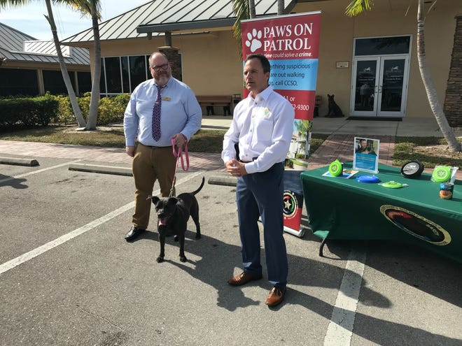 Jonathan Foerster, director of community affairs for the Humane Society Naples, Lexie the pitbull mix and CCSO Sgt. Brian Sawyer announce the Paws on Patrol initiative on Wednesday, Dec. 12, 2018.