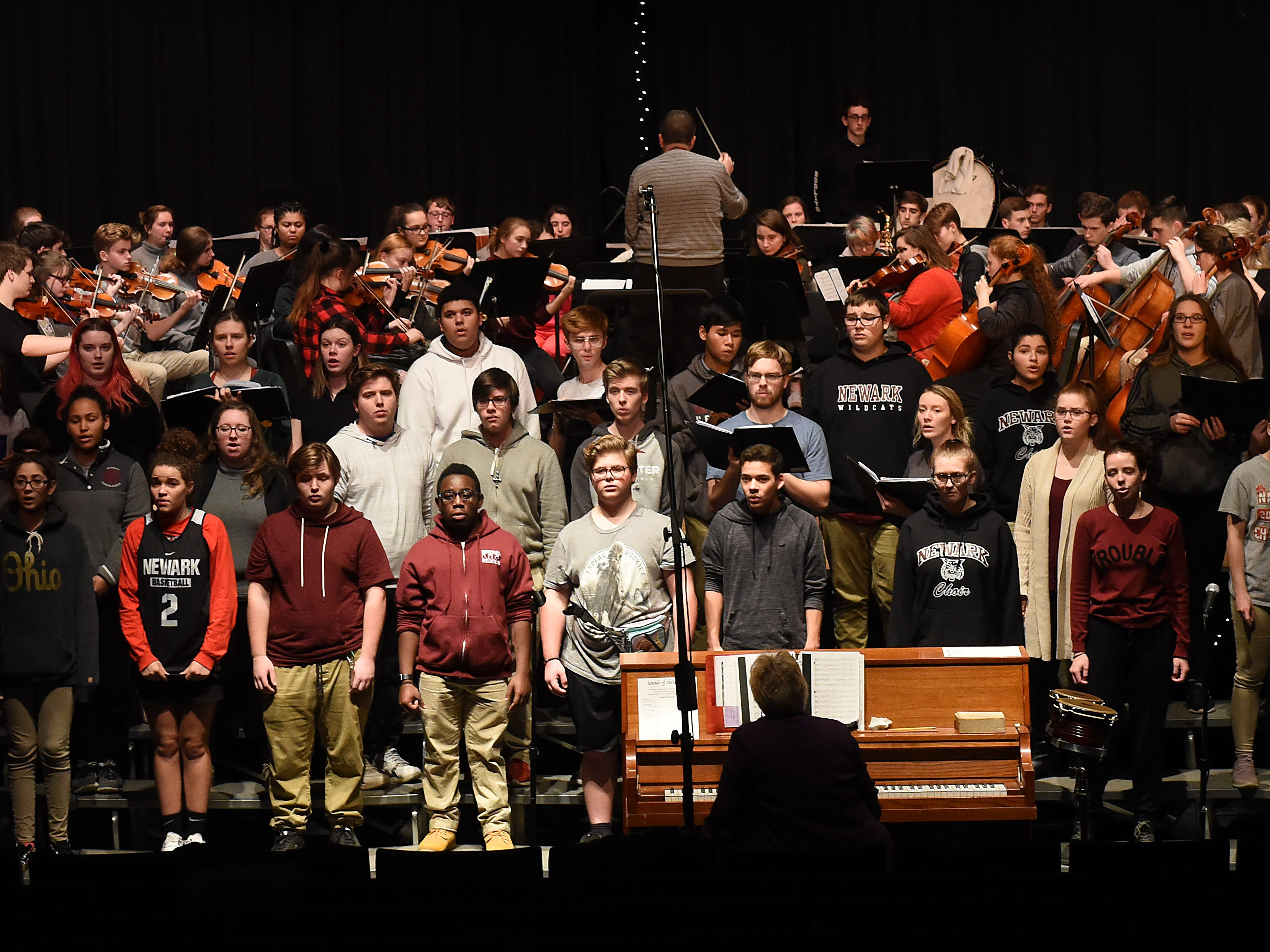 """The combined Newark High School band, choir, and orchestra rehearse for their Christmas concert at 7 p.m. on Thursday, Dec. 13, 2018 at the high school's Lawrence E. Griffin Performing Arts Center. The combined ensemble will perform Franz Gruber's classic carol """"Silent Night"""", which was written 200 years ago this Christmas, as part biggest concert performance of the year. Tickets are available at the door;  $6 for adult and $4 for students and seniors."""