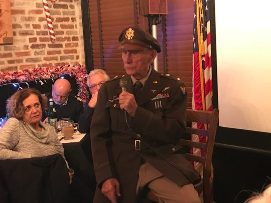 94-year-old World War II and Korean War United States Army Air Forces veteran Bob Grenz speaks to members of the U.S. Coast Guard Auxiliary Flotilla 10-01 at Sunset Pub & Grill at Lincoln Park Airport on Dec. 10, 2018.
