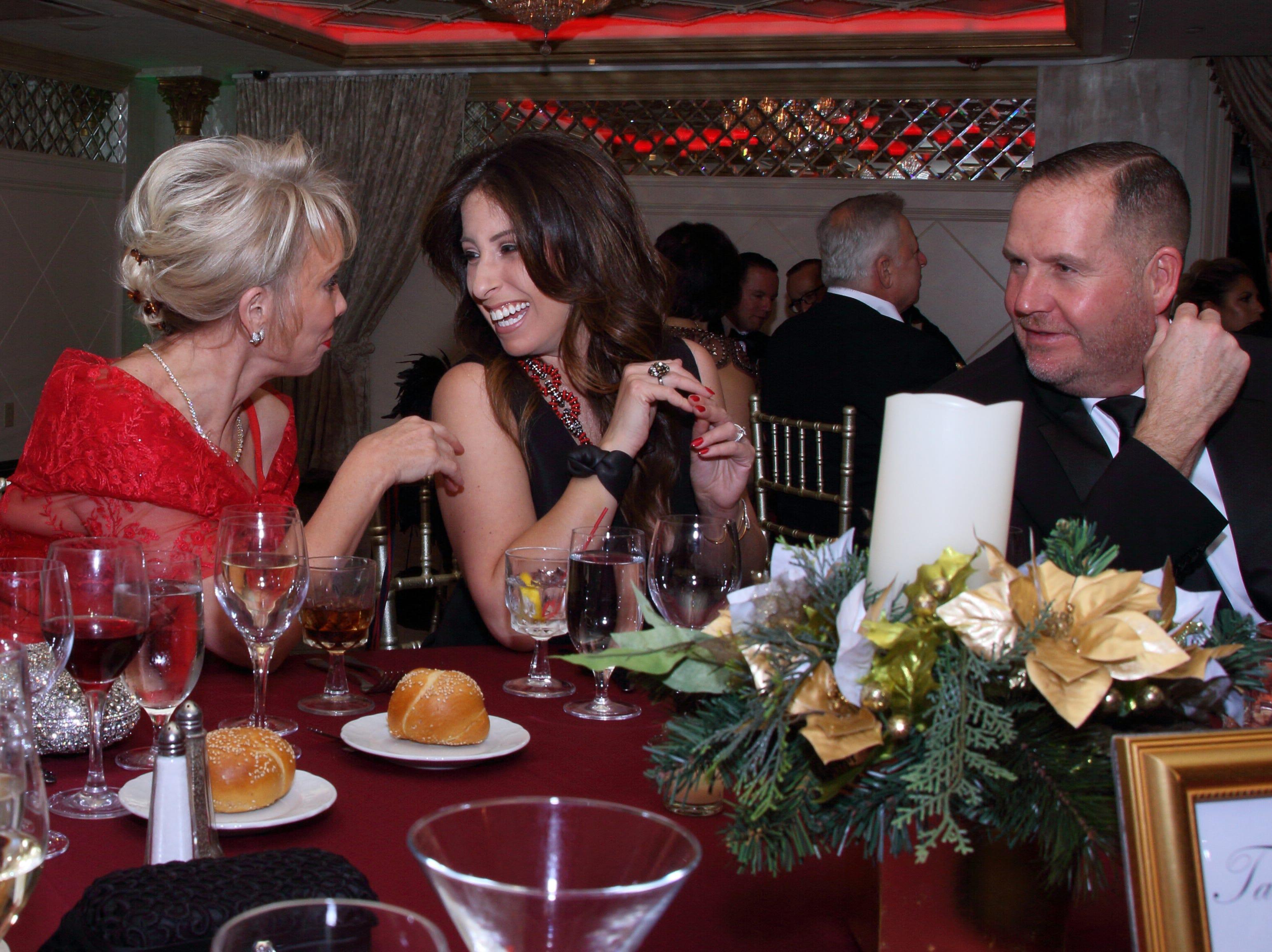 Carolyn Palmer, Dawn and Ray Donaghy. The Saddle River Valley Club held its annual Holiday Gala celebration at Seasons in Washington Township. 11/30/2018