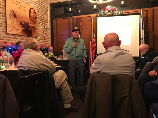 101-year-old World War II United States Army Air Forces veteran Steve Bolcar speaks to members of the U.S. Coast Guard Auxiliary Flotilla 10-01 at Sunset Pub & Grill at Lincoln Park Airport on Dec. 10, 2018.