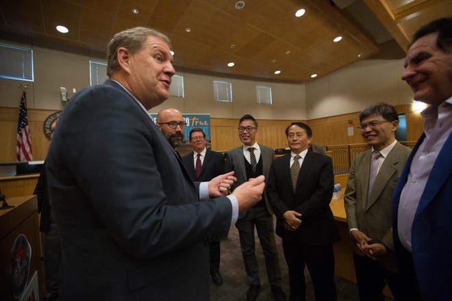 Keith Gardner, chief of staff for Gov. Susana Martinez, left, speaks with representatives from Admiral Cable, a Taiwanese company planning to open a $50 million manufacturing facility in Santa Teresa by the end of 2019. Gardner led a news conference to announce the investment Wednesday Dec. 12, 2018, at the Doña Ana County Government Center.