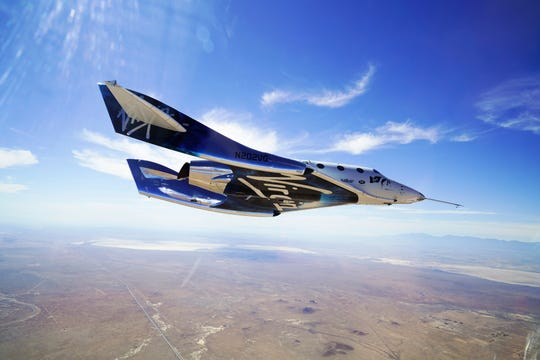 This May 29, 2018 photo provided by Virgin Galactic shows the VSS Unity craft during a supersonic flight test. The spaceship isn't launched from the ground but is carried beneath a special aircraft to an altitude around 50,000 feet. There, it's released before igniting its rocket engine and climbing.