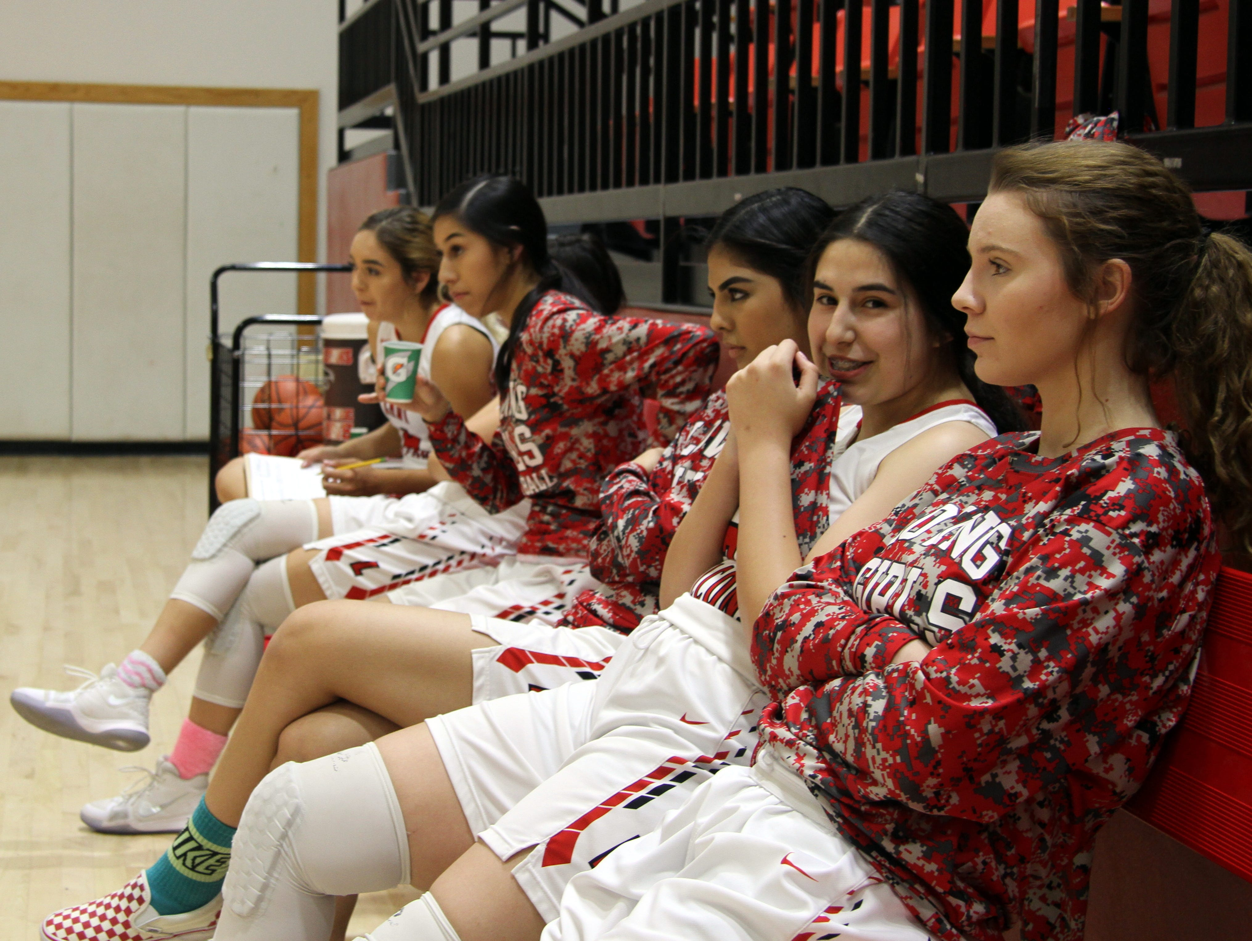 The Loving bench watches the second half of Tuesday's game against Lake Arthur. Loving won, 65-13.