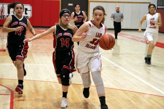 Loving's Jayden Ottman tries to outrun the Lake Arthur defense for a fastbreak during Tuesday's game.