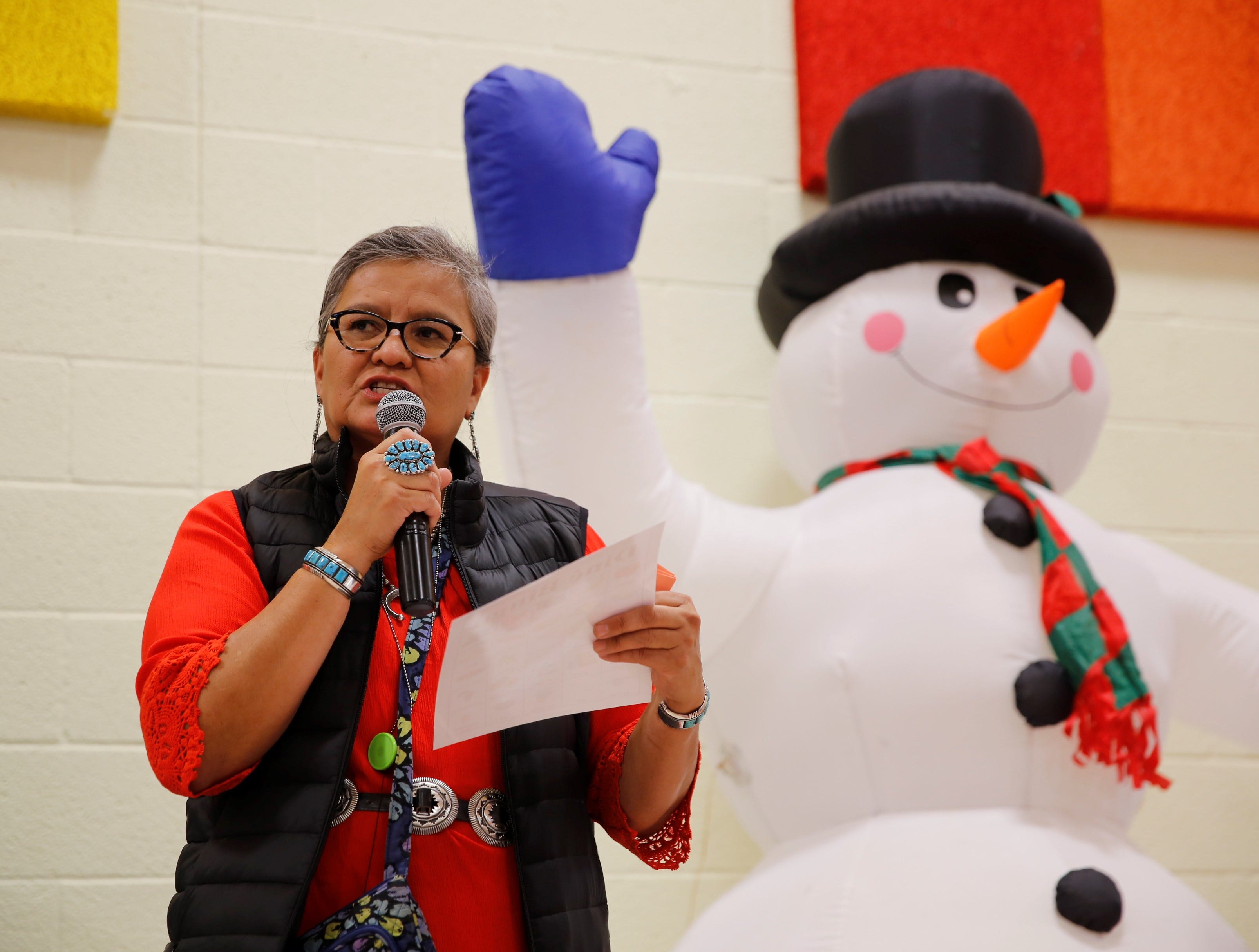 Restoring and Celebrating Family Wellness member Rosalin Smith uses the Navajo language to name food items during a game of bingo during the family winter conference at the Shiprock Youth Complex on Wednesday in Shiprock.