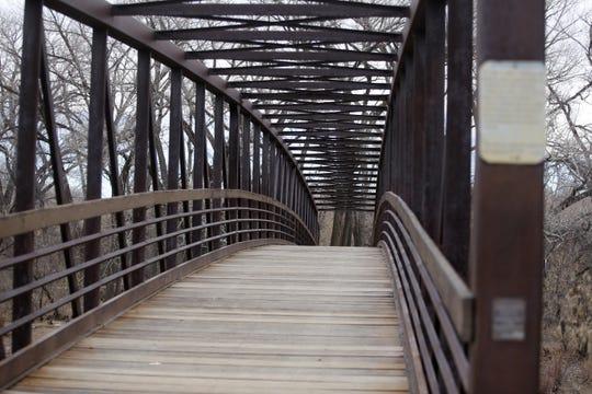 The Berg Bridge spans the Animas Rive Wednesday in Farmington. The city is considering building an aerial adventure park near Berg Bridge in Berg Park East.