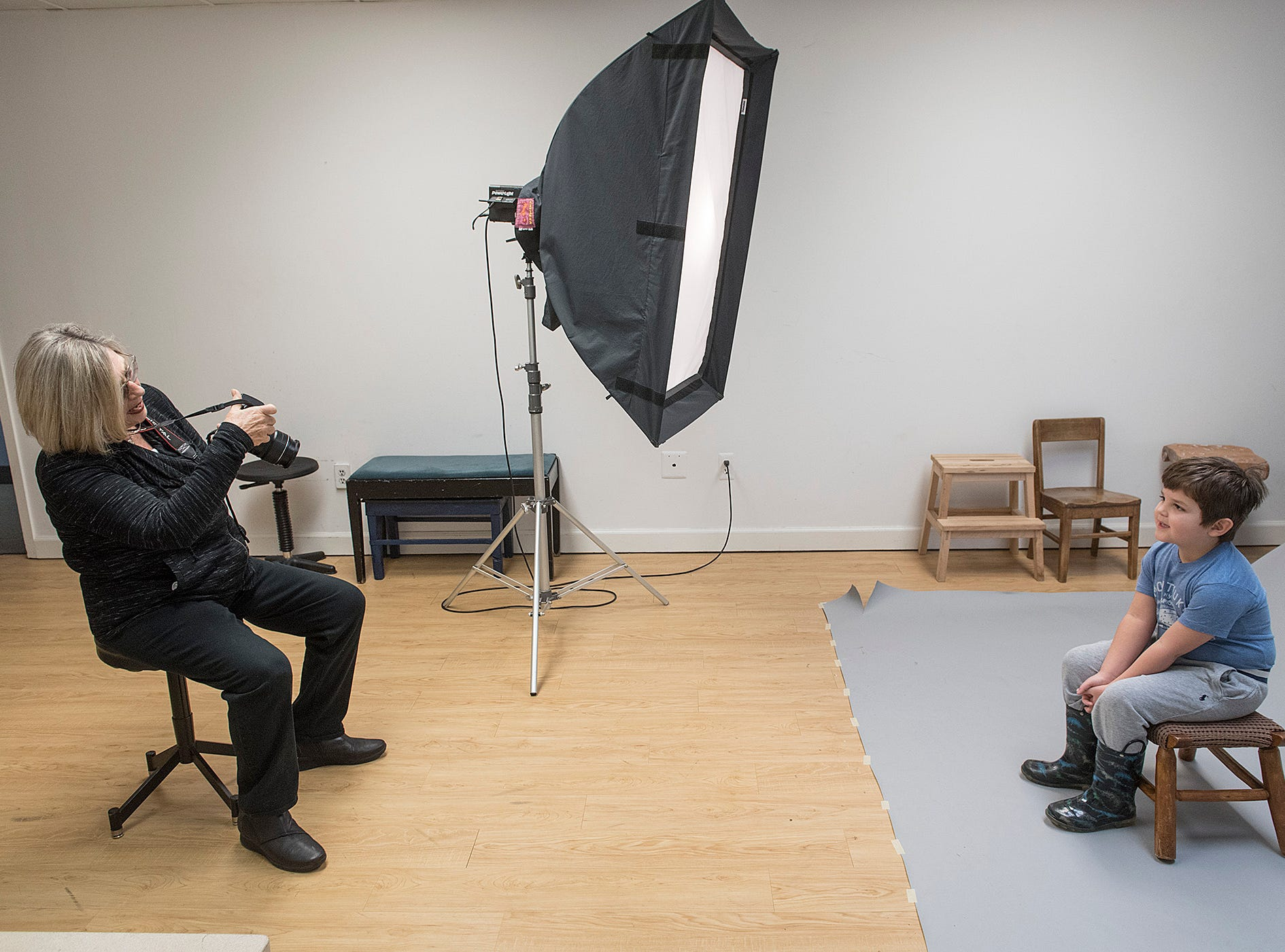 Elaine Yaker checks her last shot of five year old David Rea.