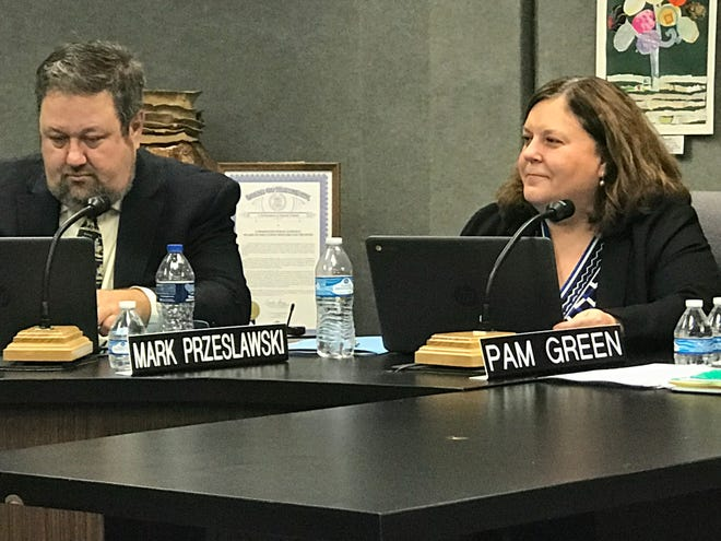 Pam Green (right, with board treasurer Mark Przeslawski) was sworn into the Farmington Board of Education Tuesday, then promptly resigned so she can take the seat she won in the November election.