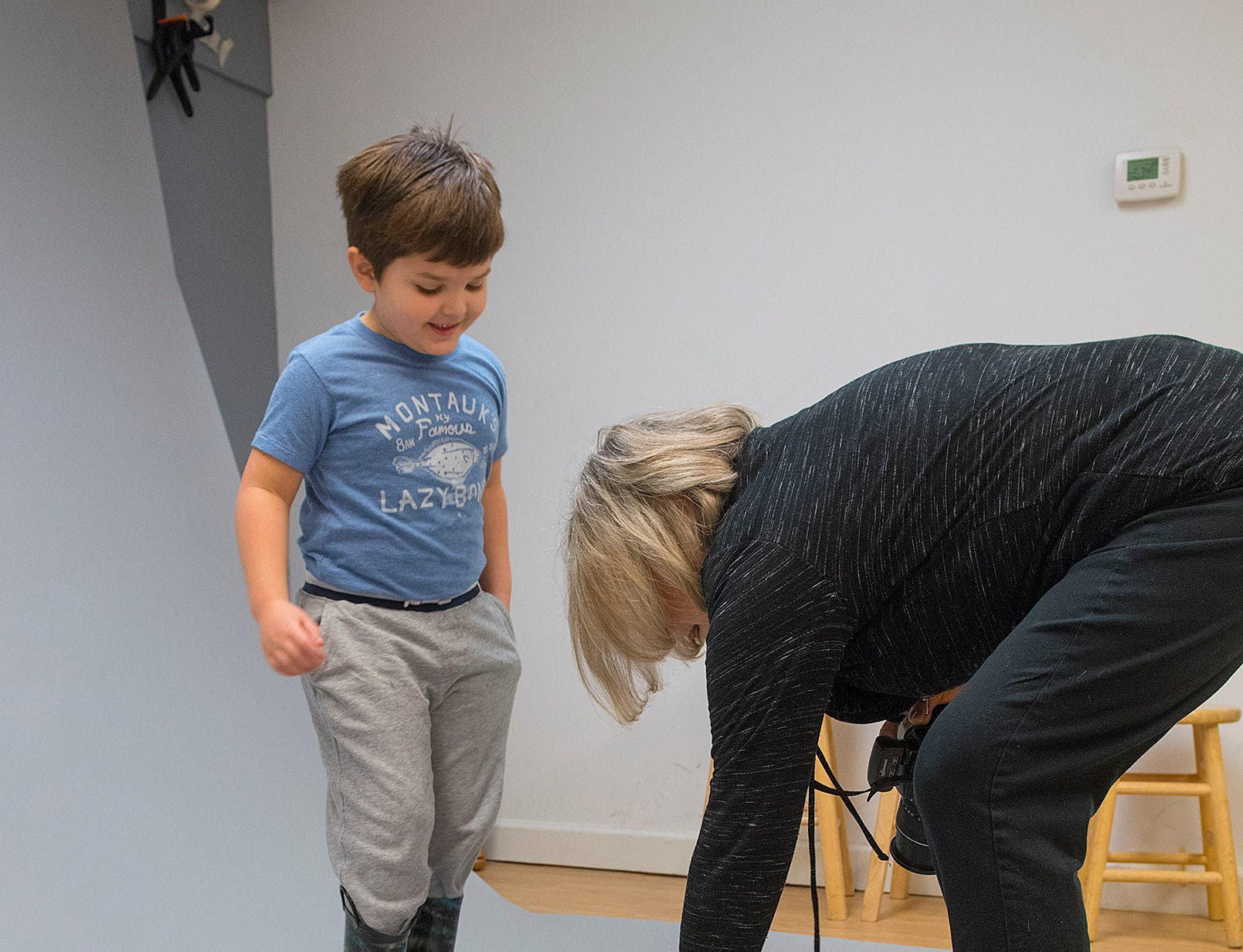 Photographer Elaine Yaker asks five year old David Rea to stand right here. He's having none of it.