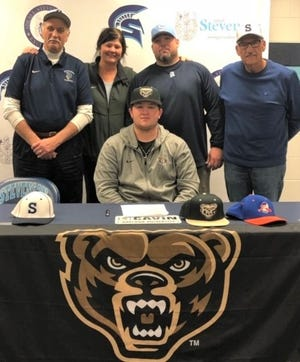 Stevenson senior catcher Bobby Cavin (seated) recently signed an NCAA Division I letter to play baseball at Oakland University. On hand for the signing ceremony were (top row, from left) head coach Rick Berryman, athletic director Lori Hyman and assistant coaches Mike Macek and Glenn Scala.