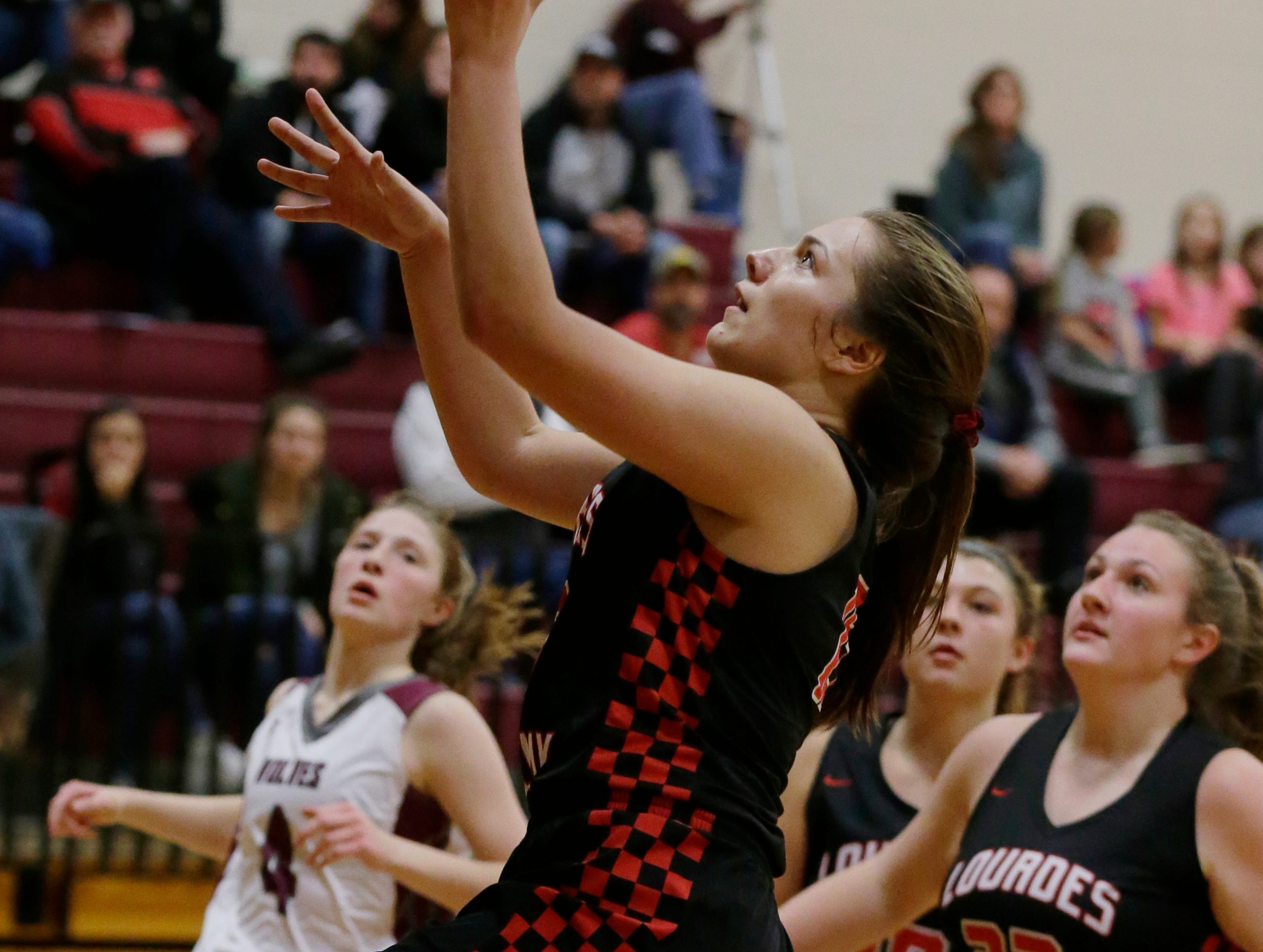 Lourdes Academy's Raechel Russo hits a layup on a fast break against Winneconne. Winneconne Wolves played Lourdes Academy Knights, Tuesday, Dec. 11, 2018.  Winneconne won 56 - 44.