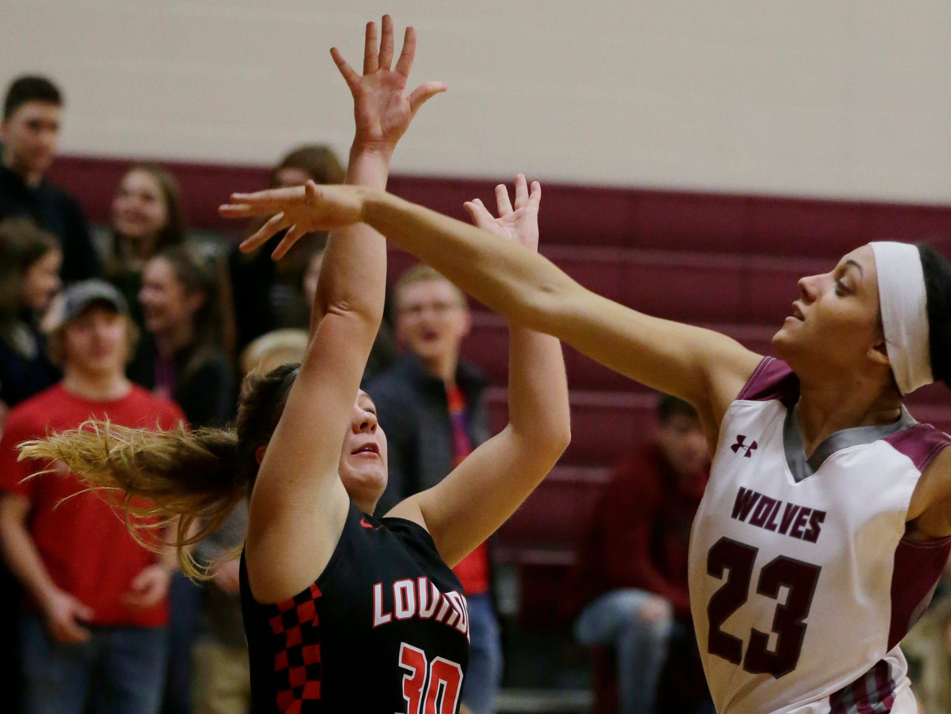 Lourdes Academy's Hope Burns gets a shot blocked by Winneconne's Airika Szafranek during the first half.  Winneconne Wolves played Lourdes Academy Knights, Tuesday, Dec. 11, 2018.  Winneconne won 56 - 44.
