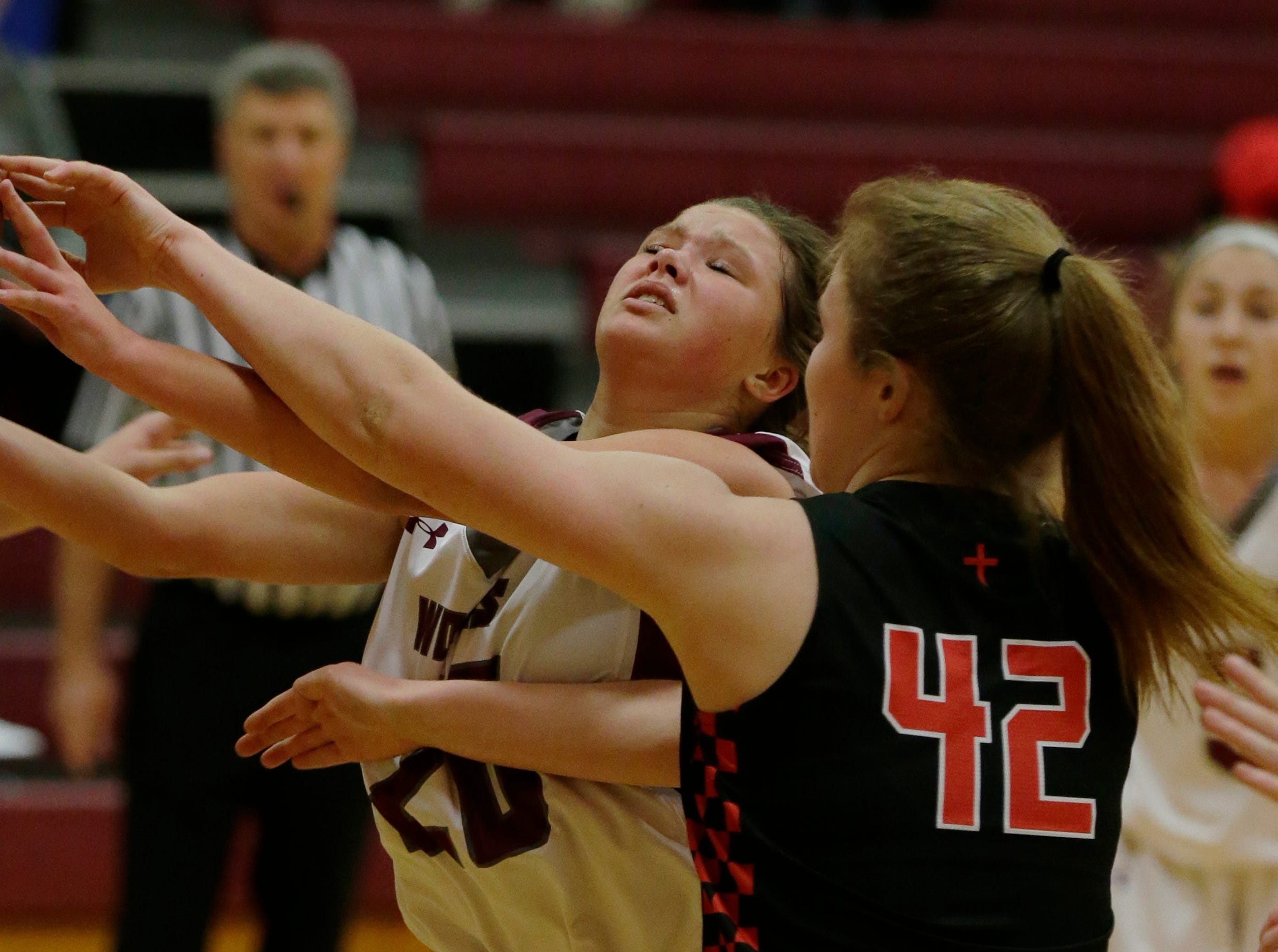 Winneconne's Claire Gentry is fouled by Lourdes Academy's Nora Sammons during their game. Winneconne Wolves played Lourdes Academy Knights, Tuesday, Dec. 11, 2018. Winneconne won 56 - 44.