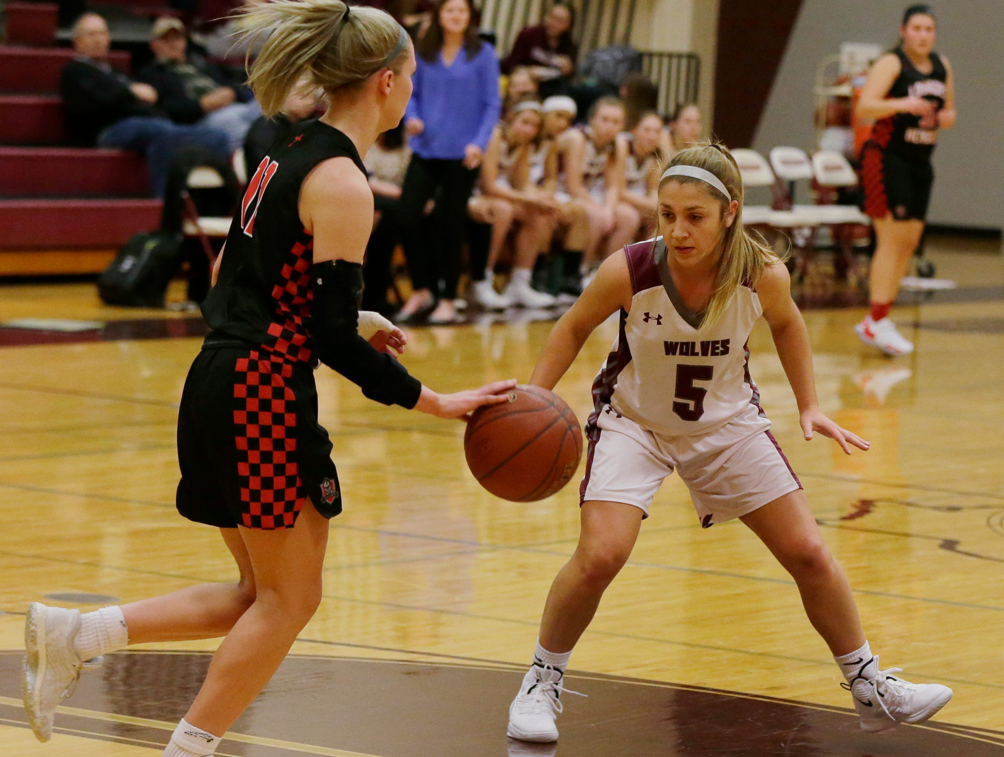 Winneconne's Kaitlyn Frierdich guards Lourdes Academy's Alexis Rolph during their game. Winneconne Wolves played Lourdes Academy Knights, Tuesday, Dec. 11, 2018. Winneconne won 56 - 44.