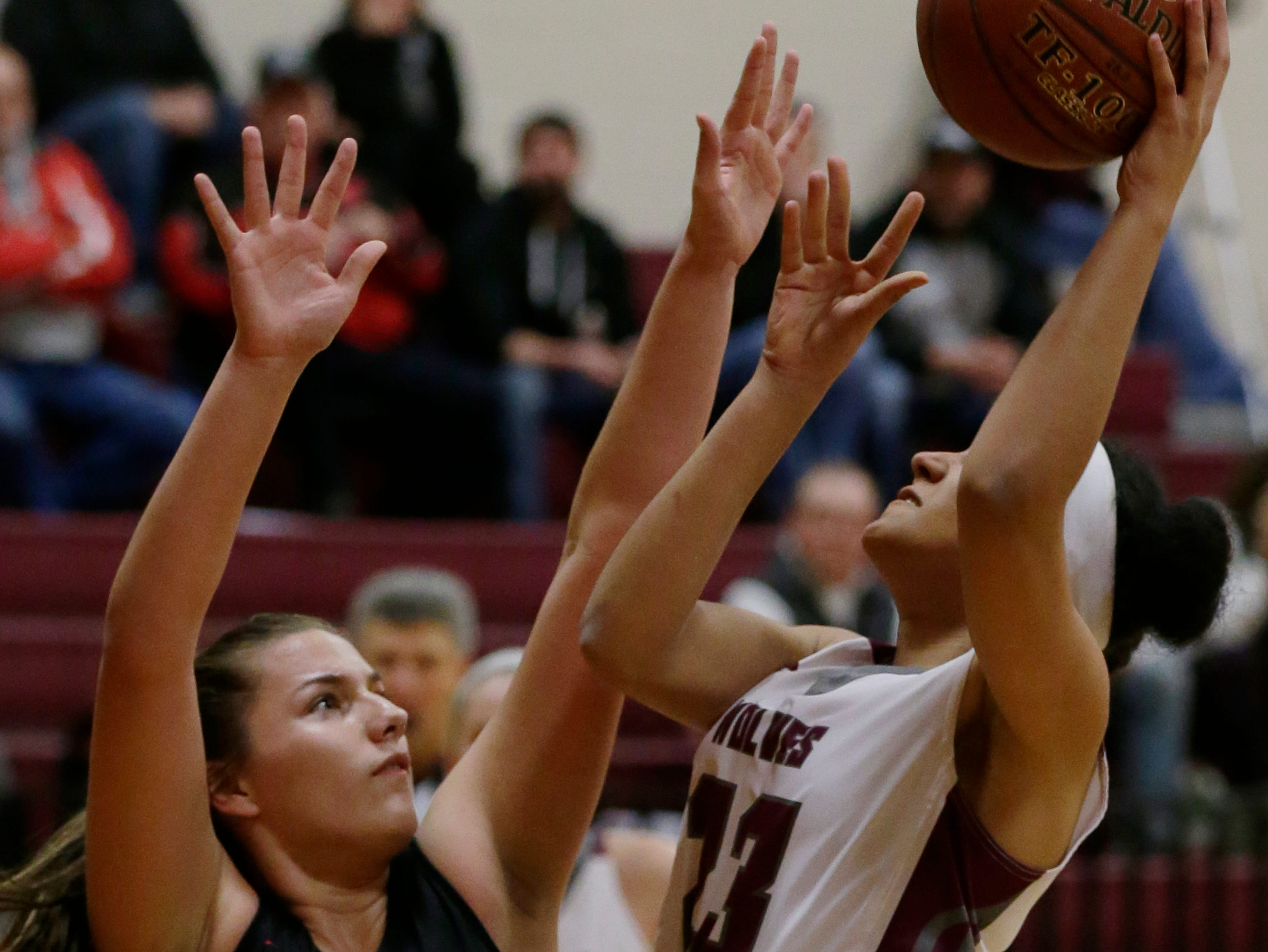Winneconne's Airika Szafranek shoots over Lourdes Academy's Raechel Russo during their game. Winneconne Wolves played Lourdes Academy Knights, Tuesday, Dec. 11, 2018. Winneconne won 56 - 44.