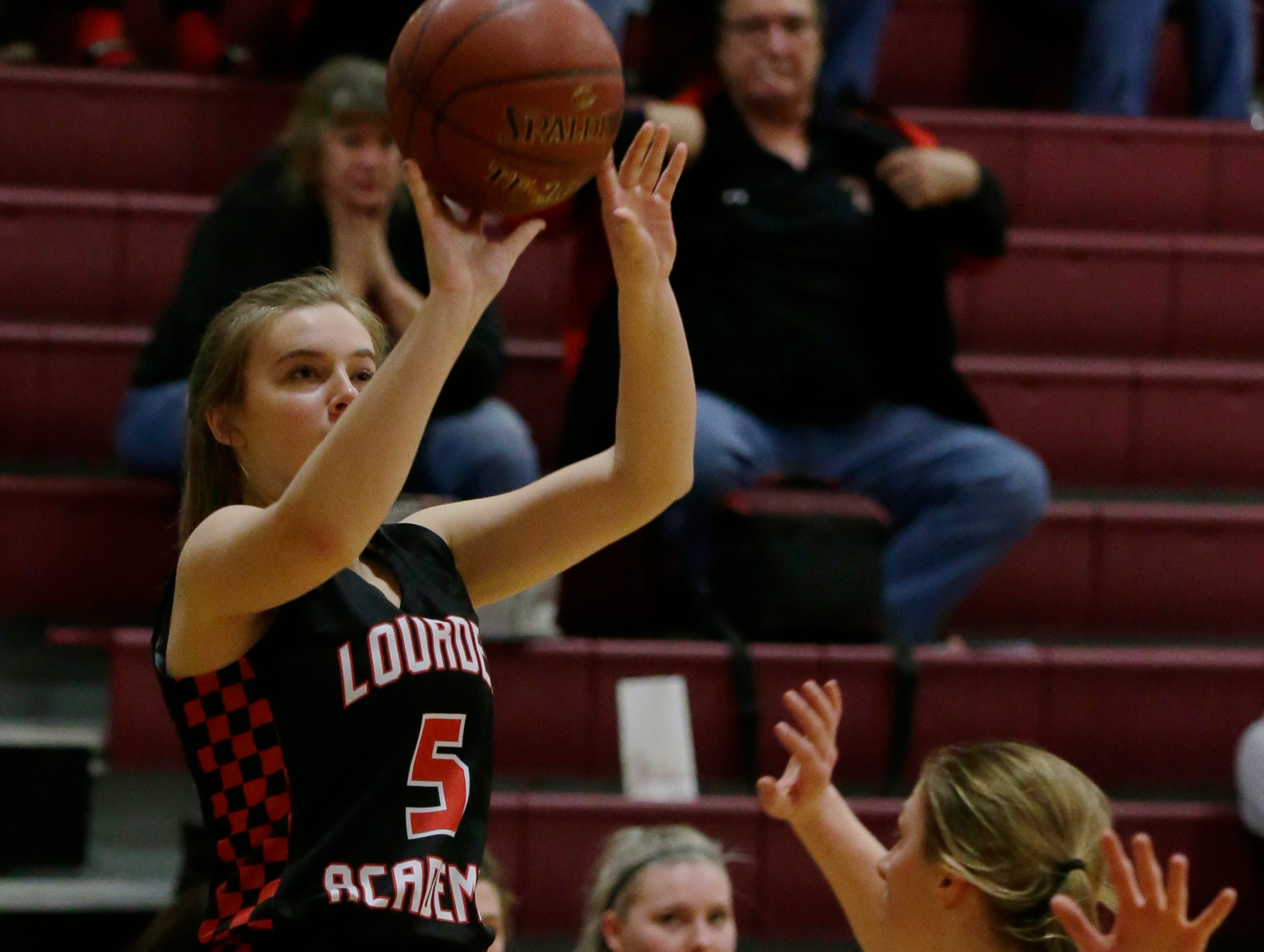 Lourdes Academy's Lauren Hamill puts up a three-point shot. Winneconne Wolves played Lourdes Academy Knights, Tuesday, Dec. 11, 2018.  Winneconne won 56 - 44.