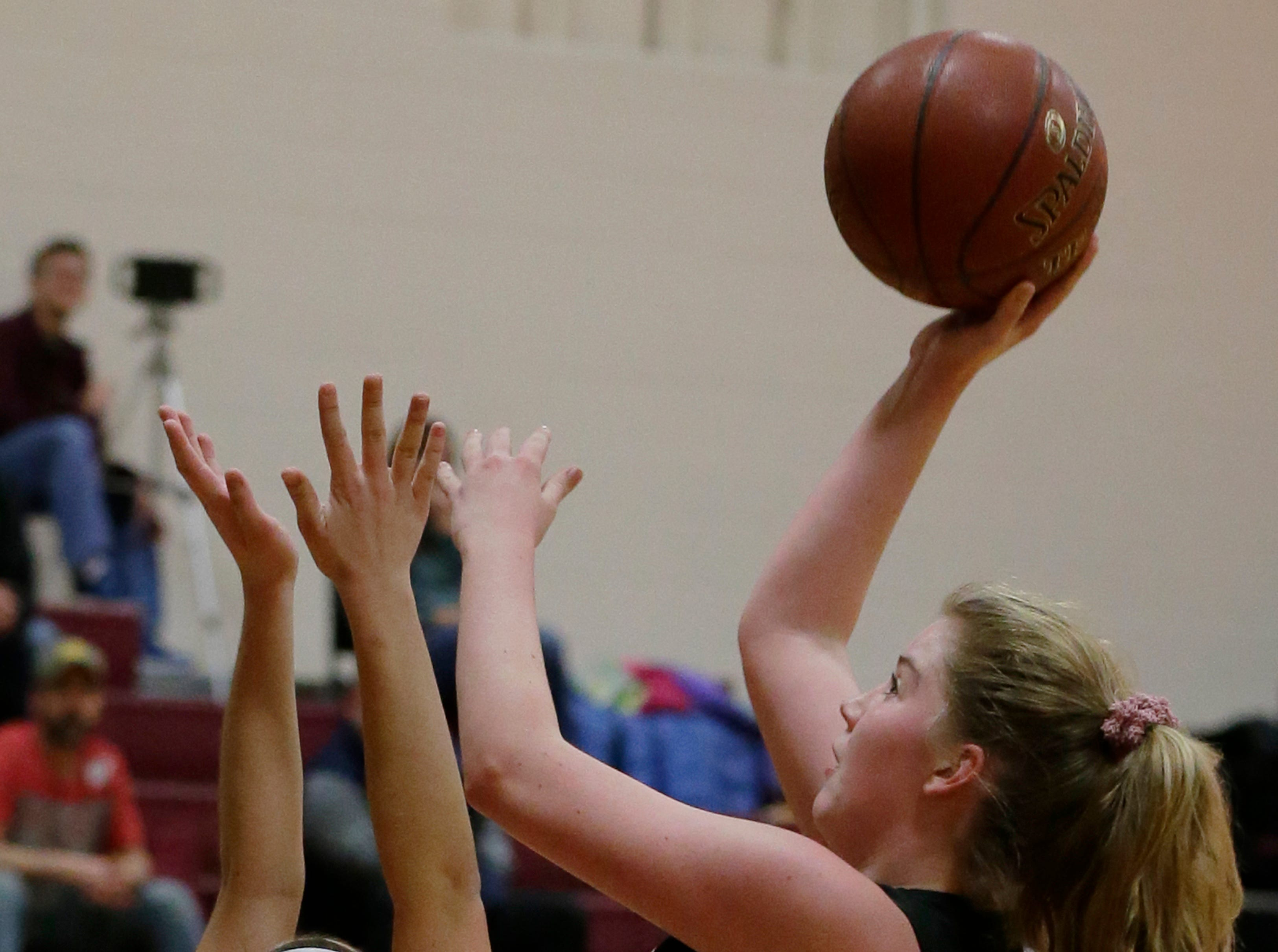 Lourdes Academy's Paige Droessler puts up a short shot in the first half of their game. Winneconne Wolves played Lourdes Academy Knights, Tuesday, Dec. 11, 2018. Winneconne won 56 - 44.