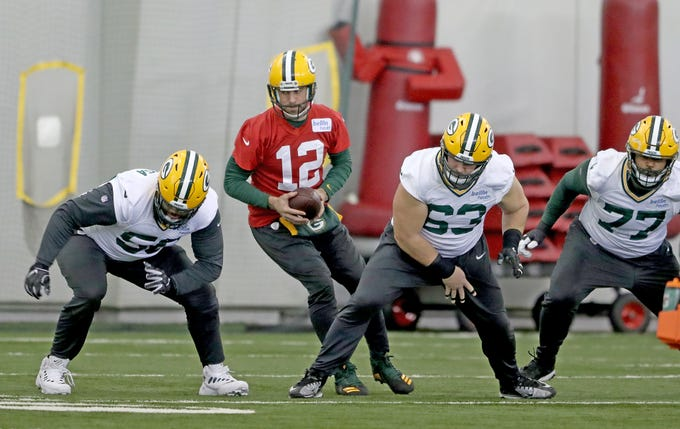 Green Bay Packers quarterback Aaron Rodgers (12) drills with an offensive line made up of Nico Siragusa (56), center Corey Linsley (63) and tackle Adam Pankey (77) during practice Wednesday, December 12, 2018 in the Don Hutson Center in Ashwaubenon, Wis.