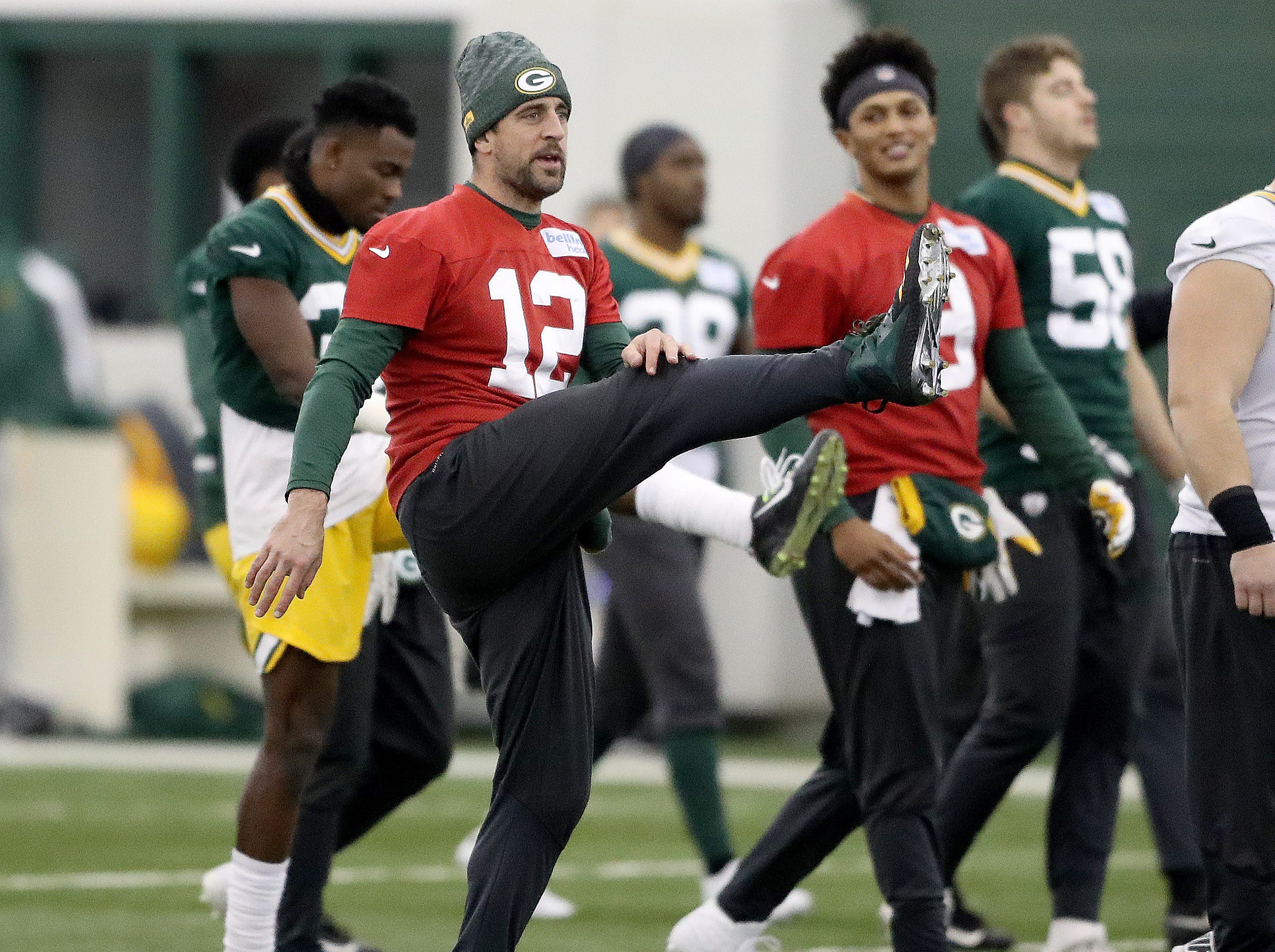 Green Bay Packers quarterback Aaron Rodgers (12) warms up during practice Wednesday, December 12, 2018 in the Don Hutson Center in Ashwaubenon, Wis.