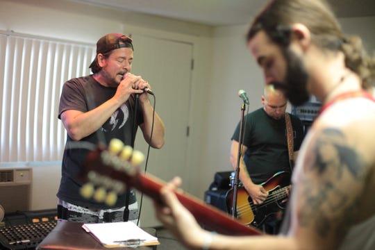 John Garcia, seen rehearsing with bandmates Mike Pygmie and Ehren Groban.