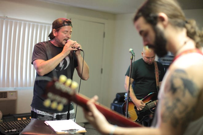 John Garcia, seen rehearsing with bandmates Mike Pygmie and Ehren Groban, will perform Saturday at the Palm Canyon Roadhouse with his Band of Gold.