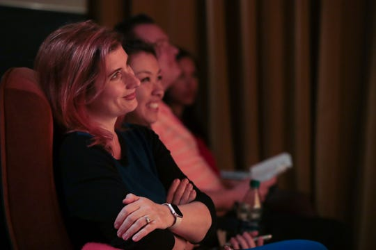 Maggie Downs listens to speakers at the Coachella Valley Storytellers Project, December 11, 2018.