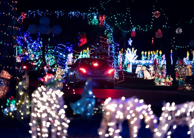 Vehicles drive through Sowell's North Pole Christmas Light Display in Milton on Tuesday, December 11, 2018.