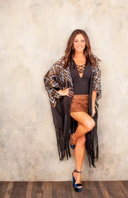 "Sara Evans will perform her ""At Christmas"" show Friday evening at the Pensacola Saenger Theatre."
