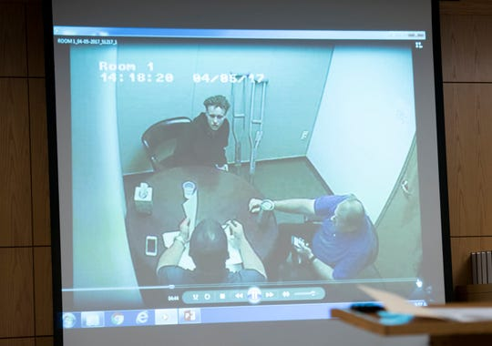 A video of Desiree Tedder being interviewed by law enforcement is played during her trial at the Escambia County Courthouse in Pensacola on Wednesday, December 12, 2018.  Tedder faces one count of murder in the death of Drulmauert Depodrek Mims.