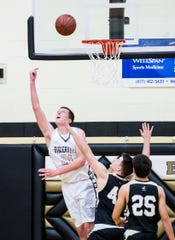 Biglerville's Drew Riley shoots a layup over his shoulder during play against Delone Catholic on December 11, 2018. The Canners won 77-65.