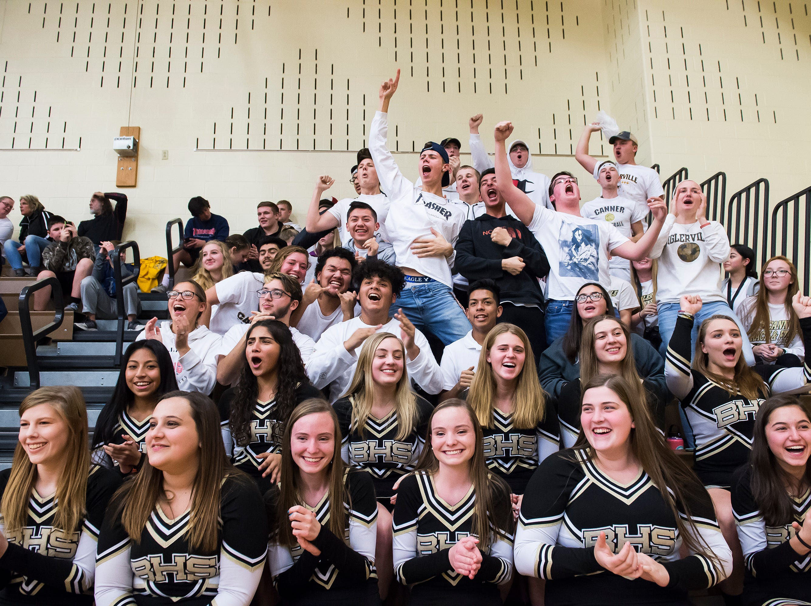 The Biglerville student section and cheerleaders celebrate as time expires on the clock and the Canners defeat Delone Catholic 77-65 at home on Tuesday, December 11, 2018.