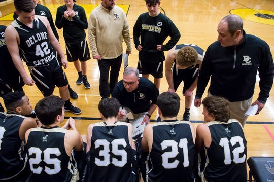 Delone Catholic head coach Darrell Wildasin talks to his players during a game against Biglerville on December 11, 2018. The Squires fell 77-65.