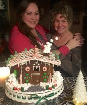 Mother and daughter with a new gingerbread masterpiece -- it only took 20 years.